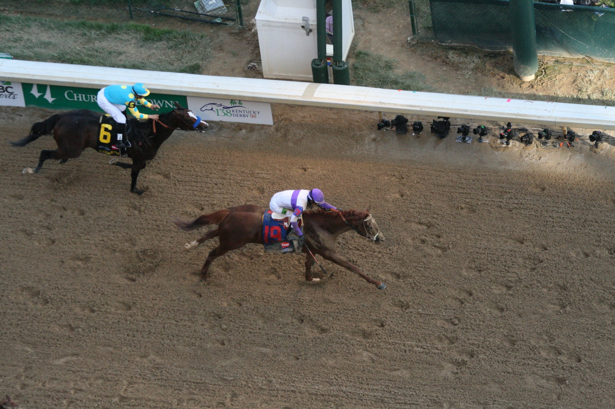 """""""I'll have Another"""" crosses the fininsh line to win the 2012 Kentucky Derby."""