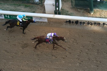 """I'll have Another"" crosses the fininsh line to win the 2012 Kentucky Derby."