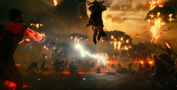 A lightning-wielding character who could be Zeus fighting Steppenwolf in 'Justice League'.