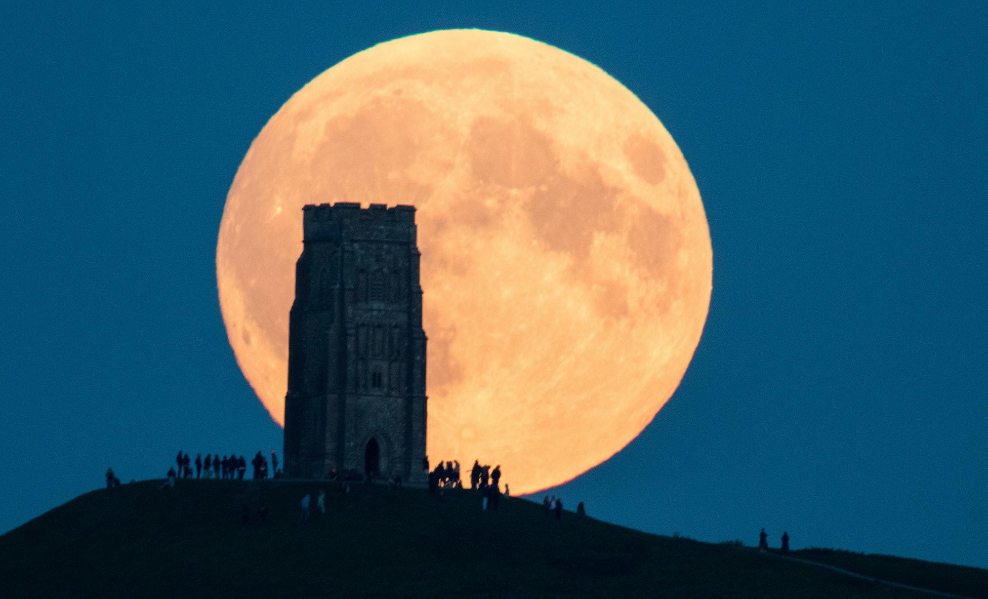 The supermoon rises behind Glastonbury Tor on September 28.