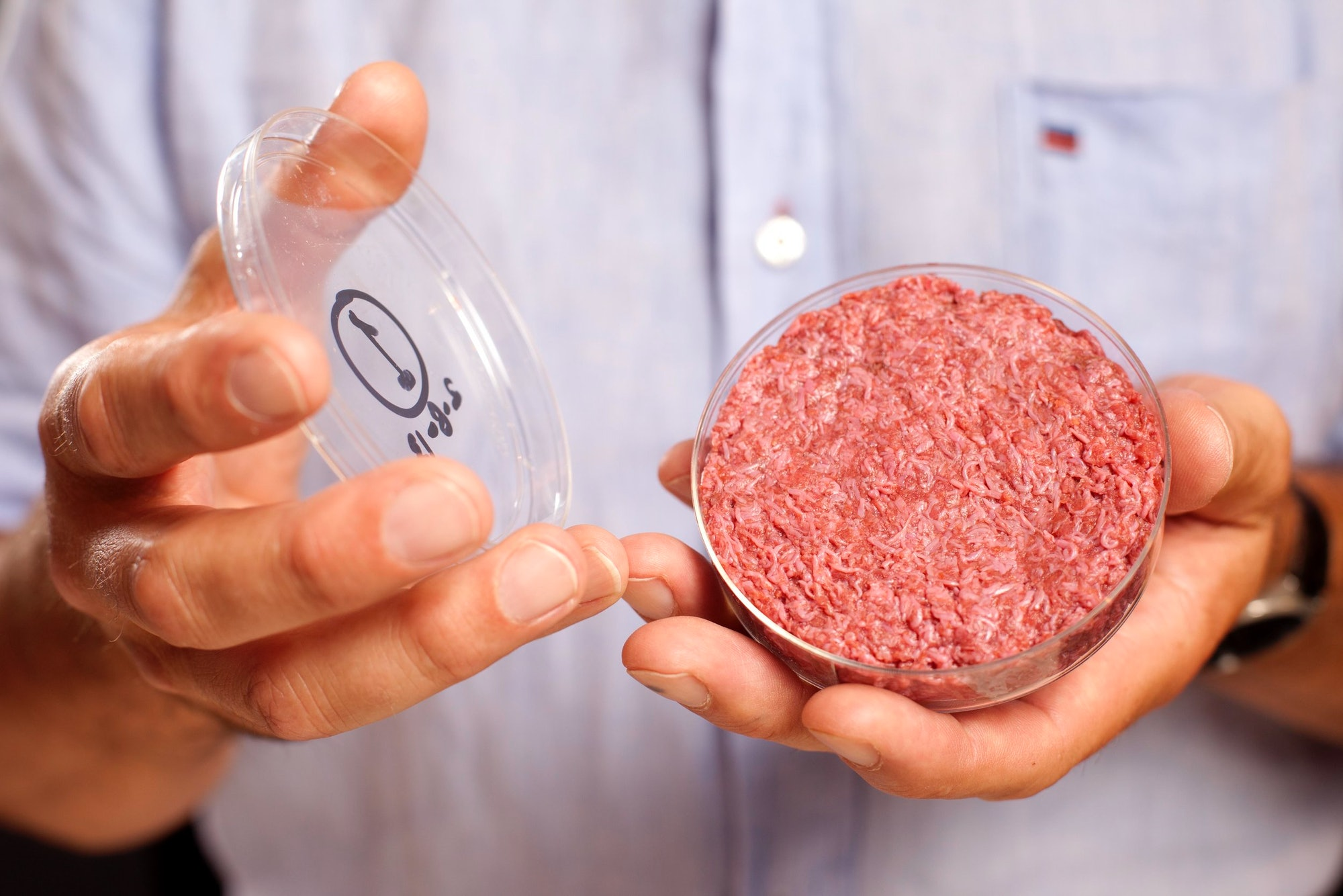 The world's first lab-grown burger, as held by Mark Post.