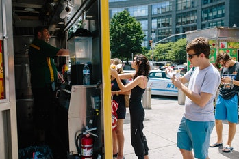 Food trucks are fun, but eating while standing can be less enjoyable.