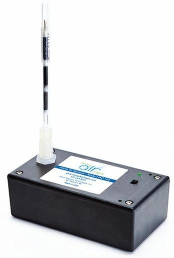 A black air quality tester.