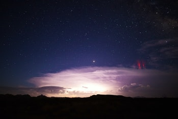 Red sprites (cold plasma lightning) above a powerful thunderstorm.