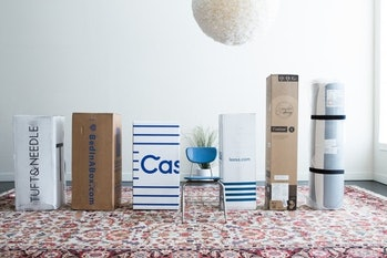 The mattresses for this guide's first test, as they would arrive at your door. From left: Tuft & Needle, BedInABox, Casper, Leesa, Signature Sleep Contour 8, IKEA Matrand.