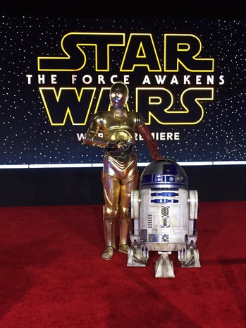 """C3PO and R2D2 arrive at the world premiere of """"Star Wars: The Force Awakens"""" in Los Angeles."""