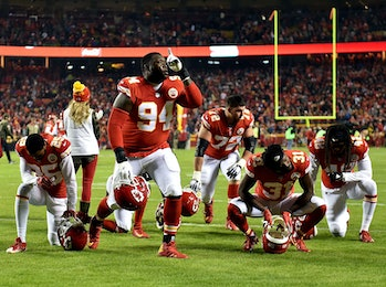 KANSAS CITY, MO - OCTOBER 30: Defensive tackle Jarvis Jenkins #94 and members of the Kansas City Chiefs pray after the game against the Denver Broncos at Arrowhead Stadium on October 30, 2017 in Kansas City, Missouri. (Photo by Peter Aiken/Getty Images)
