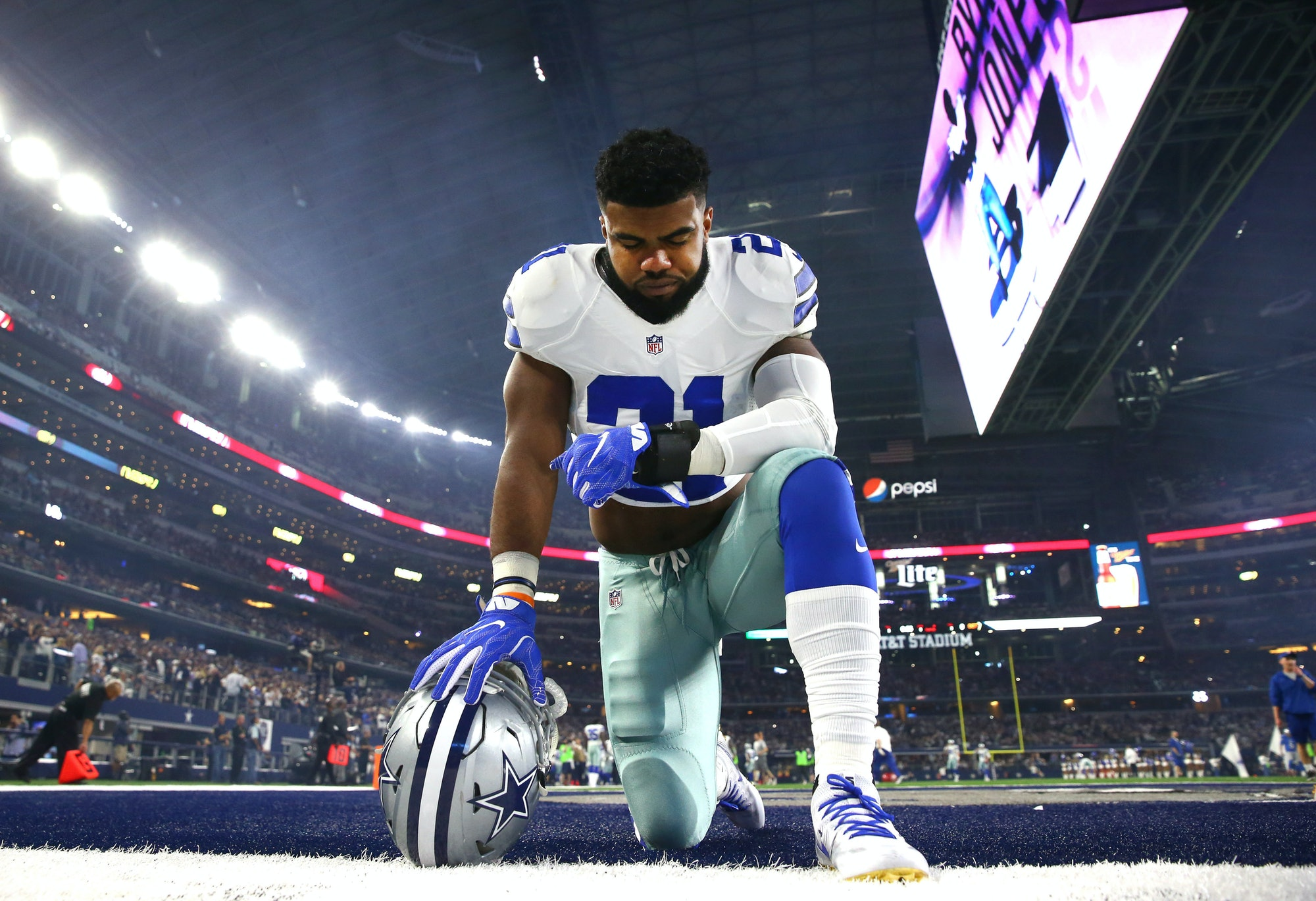ARLINGTON, TX - DECEMBER 26: Ezekiel Elliott #21 of the Dallas Cowboys takes a knee in the end zone before the Cowboys played the Detroit Lions at AT&T Stadium on December 26, 2016 in Arlington, Texas. (Photo by Tom Pennington/Getty Images)