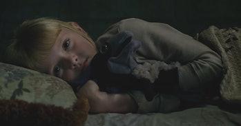 A young Illyana Rasputin/Magik holding a stuffed toy Lockheed -- 'The New Mutants'
