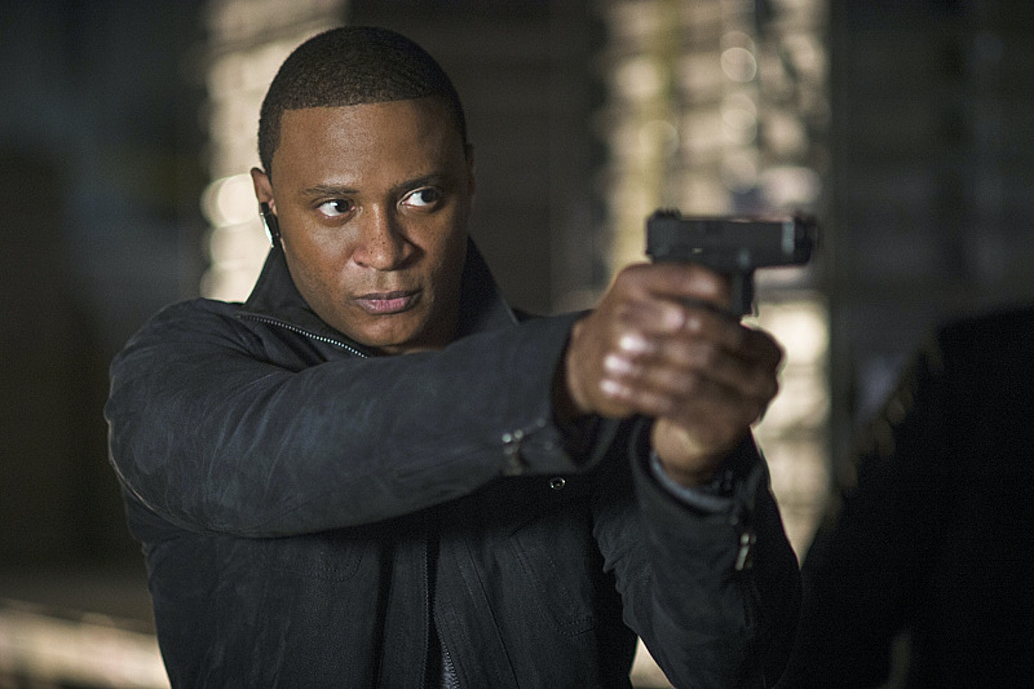 Diggle holds a gun on 'Arrow'