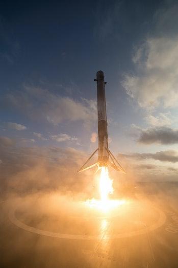 The rocket landing back on the droneship.