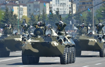 MINSK, RUSSIA - MAY 9: In this handout image supplied by Host photo agency / RIA Novosti, BTR-80 armored personnel carriers during the celebration of the 70th anniversary of Victory in the 1941-1945 Great Patriotic War in the Hero City of Minsk, May 9,2015in Minsk, Russia. The Victory Day parade commemorates the end of World War II in Europe. (Photo by Host photo agency / RIA Novosti via Getty Images)