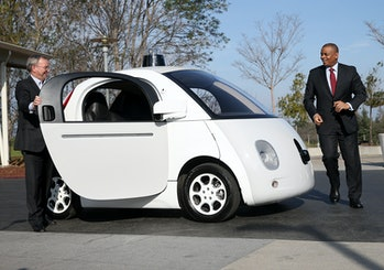 U.S. Transportation Secretary Anthony Foxx and Google Chairman Eric Schmidt (left) get out of a Google self-driving car at the Google headquarters on February 2, 2015 in Mountain View, California.
