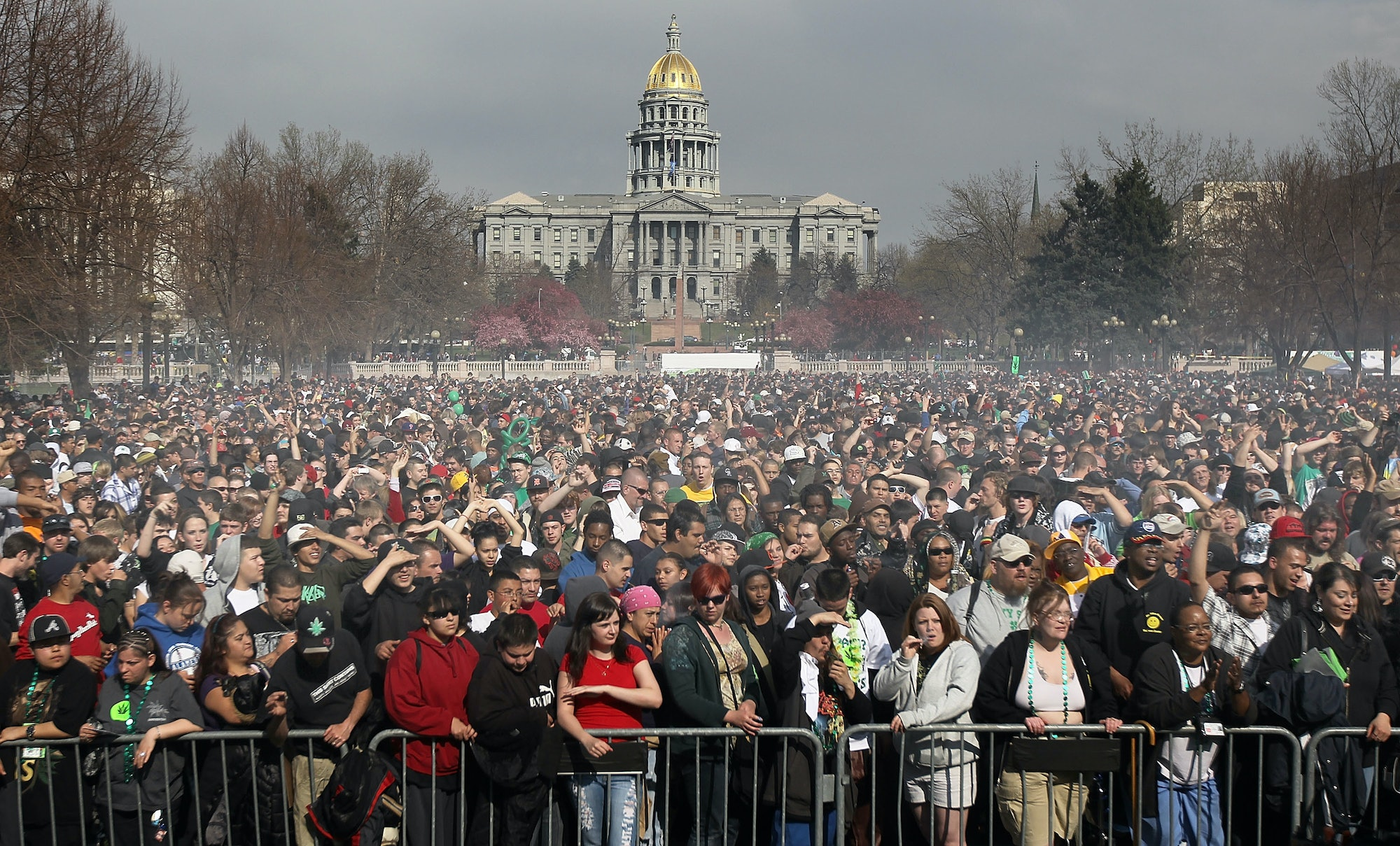 Marijuana smoke rises from a smoking crowd on April 20,2010, at a pro-pot '4/20' celebration in front of the State Capitol building in Denver, Colorado.