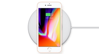 An iPhone 8 charging wirelessly.