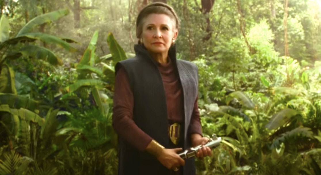 Leia holds the famous Skywalker family lightsaber in 'Star Wars: The Rise of Skywalker'