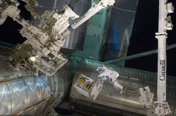Astronauts at the International Space Station working on rocket refueling experiments.