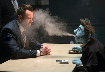 Phil Philips blasts an impossible amount of cigarette smoke into the face of Joel McHale's FBI agent...