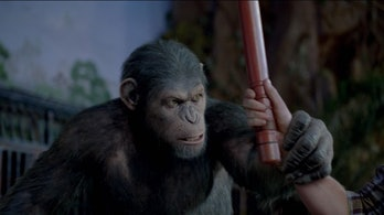 war for the planet of the apes caesar grabs hand