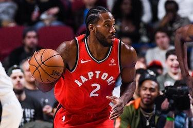 MONTREAL, QC - OCTOBER 10: Toronto Raptors Forward Kawhi Leonard (2) runs while dribbling the ball d...