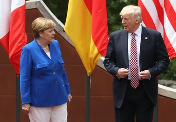 TAORMINA, ITALY - MAY 26: German Chancellor Angela Merkel and U.S. President Donald Trump arrive for the group photo at the G7 Taormina summit on the island of Sicily on May 26, 2017 in Taormina, Italy. Following the summit Chancellor Merkel expressed her disappointment that the Trump administration was unwilling to join the other six G7 member states on joint statements on climate change and refugees and said too that the E.U. could no longer count on the U.S. as the same reliable partner as with previous U.S. administrations. Meanwhile White House spokesman Sean Spicer said May 31 that Trump and Merkel are on very good terms. (Photo by Sean Gallup/Getty Images)