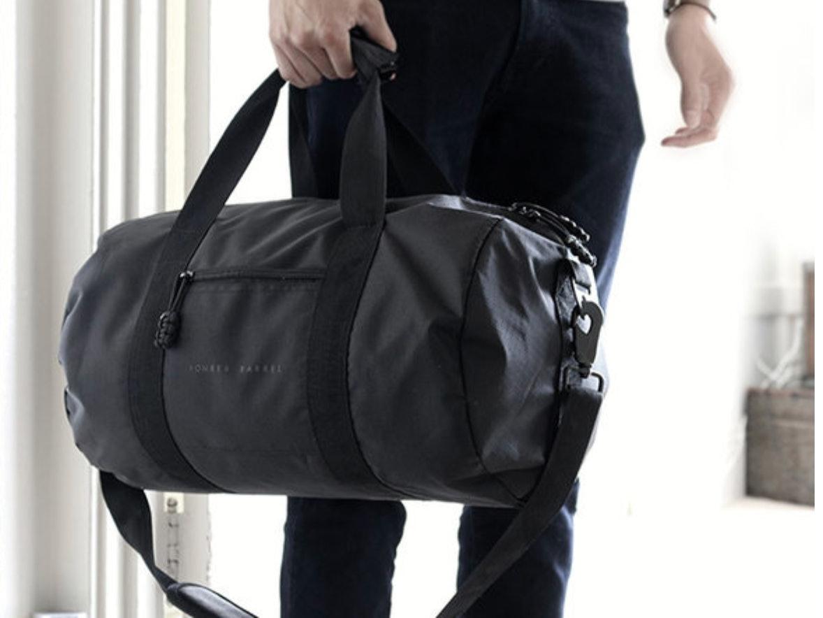 travel, bomber barrel duffel bag, luggage, suitcase, travel essentials, commute bags