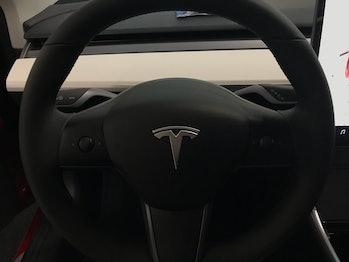 The Tesla Model 3's white interior.