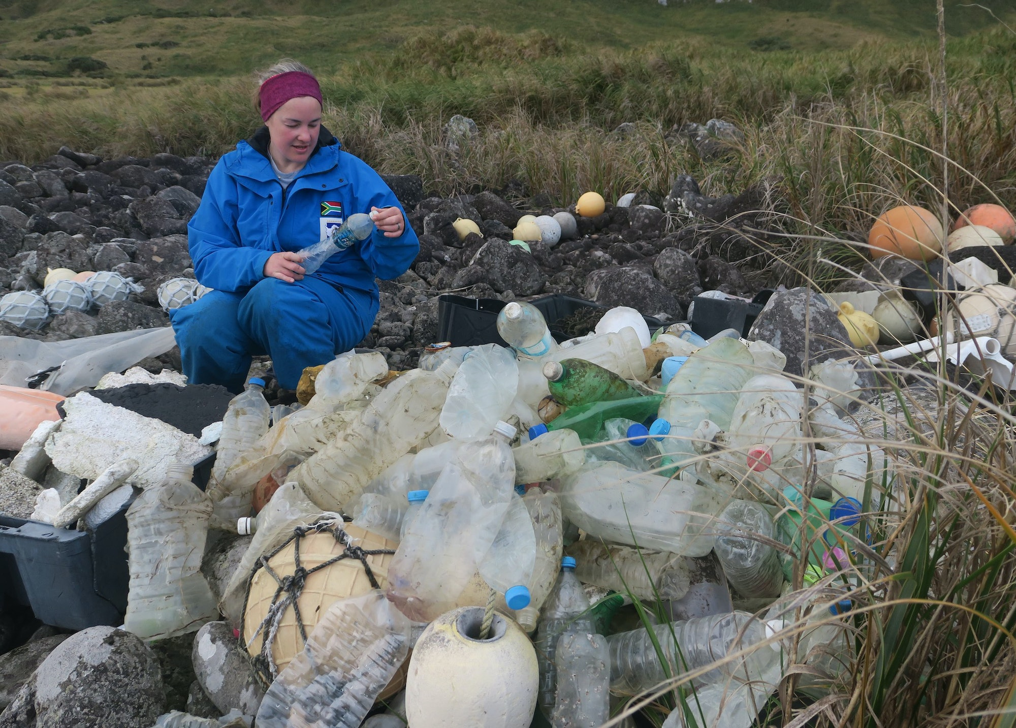 Study co-author Maelle Connan inspects bottles to see where they came from.