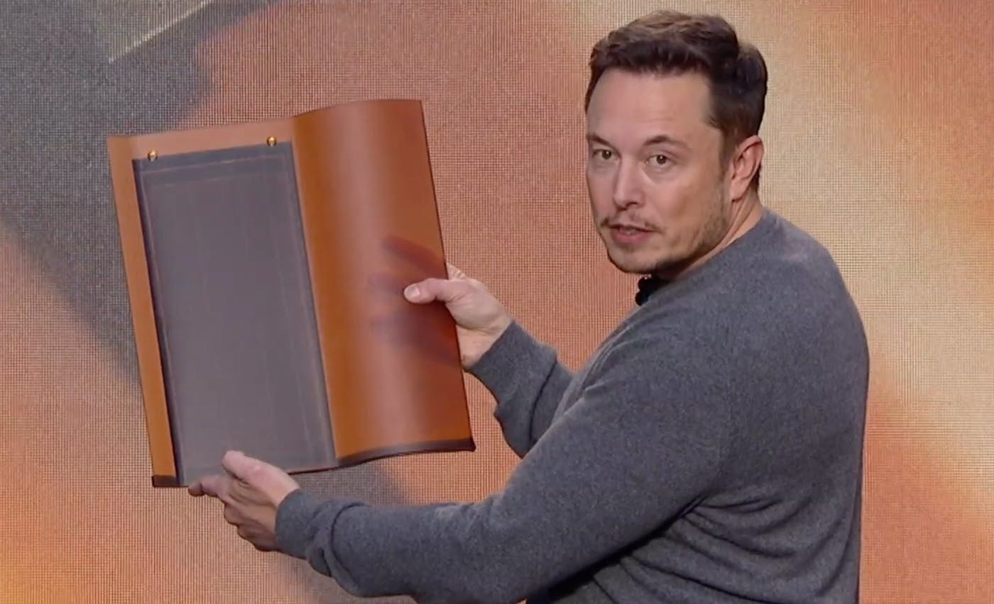 Musk holding a Tuscan roof tile