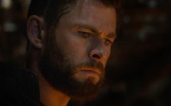 Chris Hemsworth as Thor in the 'Avengers: Endgame' trailer. He's brooding somewhere dark.