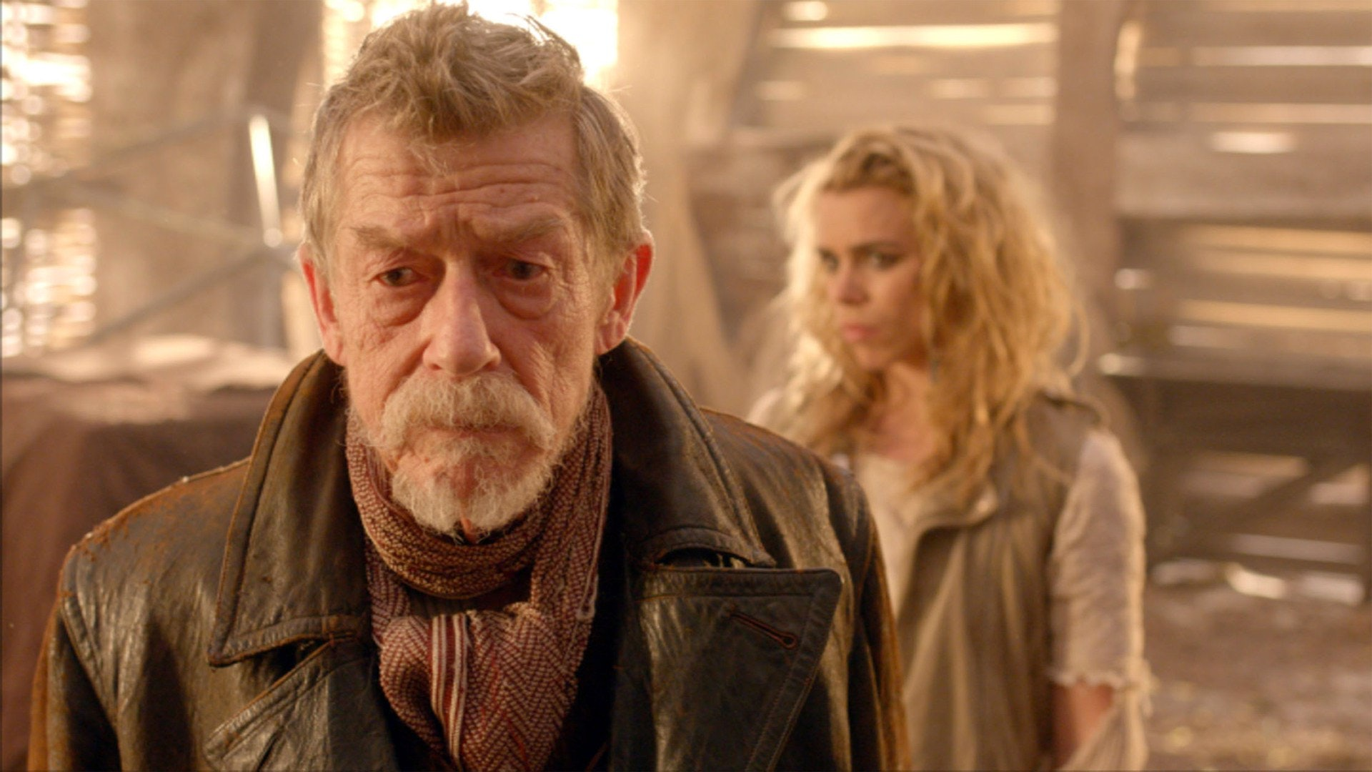 The War Doctor (John Hurt) and a physical manifestation of a weapon called The Moment, taking the form of Rose Tyler (Billie Piper).