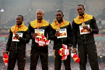 BEIJING, CHINA - AUGUST 30: Gold medalists Nickel Ashmeade of Jamaica, Asafa Powell of Jamaica, Usain Bolt of Jamaica and Nesta Carter of Jamaica pose on the podium during the medal ceremony for the Men's 4x100 Metres Relay final during day nine of the 15th IAAF World Athletics Championships Beijing 2015 at Beijing National Stadium on August 30, 2015 in Beijing, China. (Photo by Patrick Smith/Getty Images)