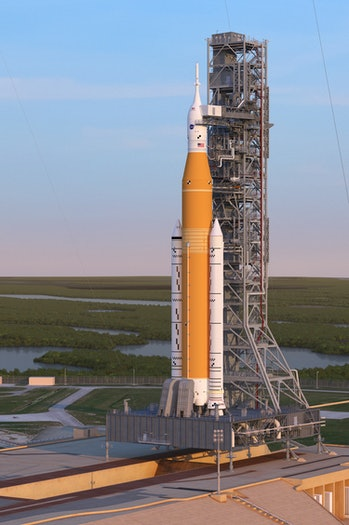 Artist's rendering of the Space Launch System Block 1 sitting on Launch Pad 39A with the Orion spacecraft at sunrise.