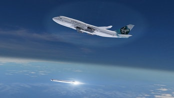Virgin Orbit's new LauncherOne rocket launches from Cosmic Girl, a Boeing 747-400 aircraft modified ...