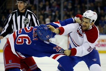NEW YORK, NY - APRIL 22: Jimmy Vesey #26 of the New York Rangers fights with Max Pacioretty #67 of the Montreal Canadiens during the first period in Game Six of the Eastern Conference First Round during the 2017 NHL Stanley Cup Playoffs at Madison Square Garden on April 22, 2017 in New York City. (Photo by Bruce Bennett/Getty Images)