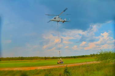"A ""Dismounted Soldier Autonomy Tools,"" or DSAT, being lowered by a helicopter."