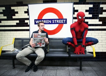 Even Spider-Man has to wait for the tube sometimes.
