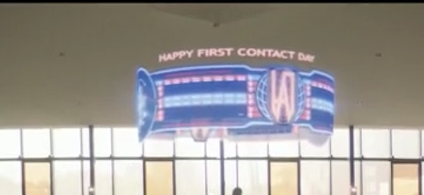 """The holographic banner in 'Children of Mars' proclaiming """"Happy First Contact Day."""""""