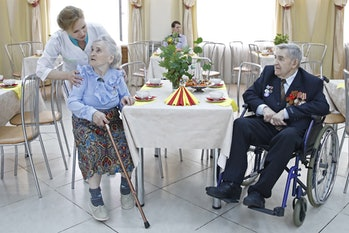A nurse looking over patients at a home for the elderly in Russia. Jobs like these, requiring empathy and personal connection, are likely safe from automation.