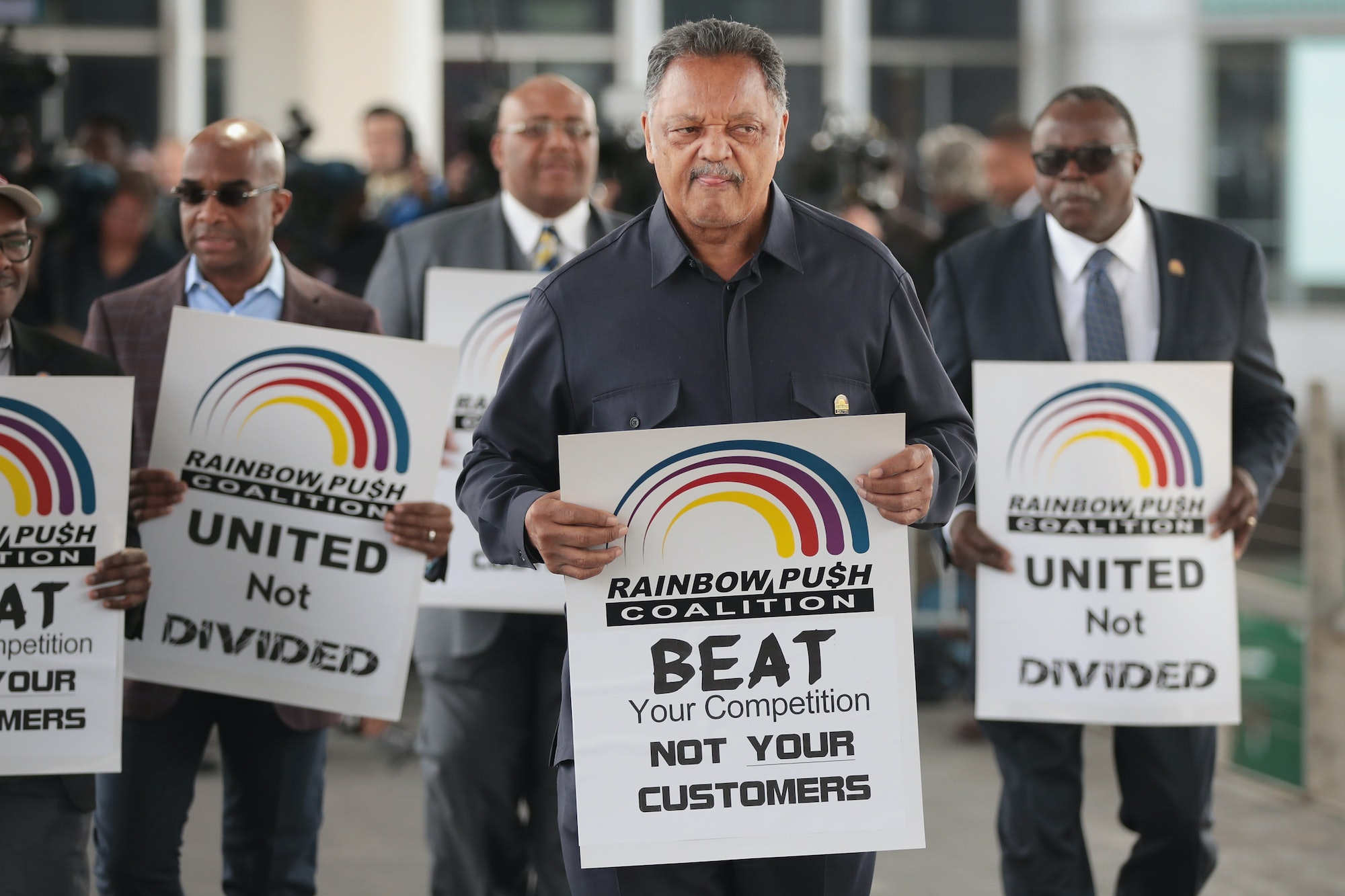 Civil rights leader Reverend Jesse Jackson leads a small group from the Rainbow PUSH Coalition in a protest outside the United Airlines terminal at O'Hare International Airport on April 12,corporate image after a cell phone video was released showing a passenger being dragged from his seat and bloodied by airport police after he refused to leave a reportedly overbooked flight that was preparing to fly from Chicago to Louisville.