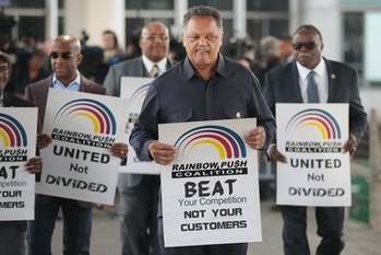 Civil rights leader Reverend Jesse Jackson leads a small group from the Rainbow PUSH Coalition in a protest outside the United Airlines terminal at O'Hare International Airport on April 12, corporate image after a cell phone video was released showing a passenger being dragged from his seat and bloodied by airport police after he refused to leave a reportedly overbooked flight that was preparing to fly from Chicago to Louisville.