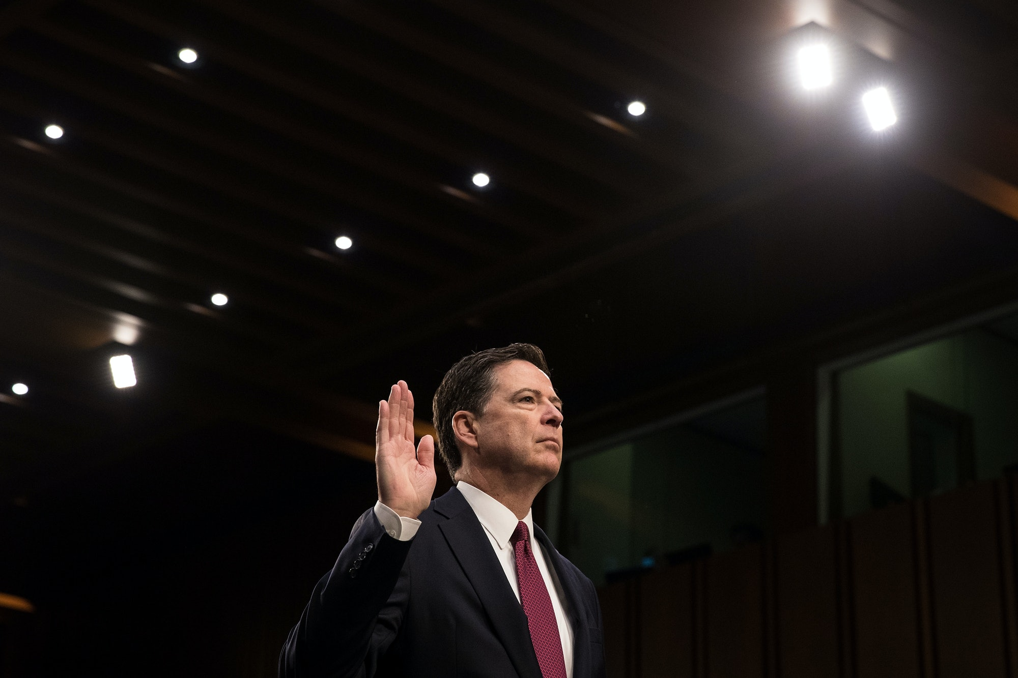 WASHINGTON, DC - JUNE 08: Former FBI Director James Comey is sworn in before the Senate Intelligence Committee in the Hart Senate Office Building on Capitol Hill June 8, 2017 in Washington, DC. Comey said that President Donald Trump pressured him to drop the FBI's investigation into former National Security Advisor Michael Flynn and demanded Comey's loyalty during the one-on-one meetings he had with president. (Photo by Drew Angerer/Getty Images)
