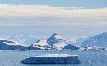 glacial calving ice falling into water antarctica