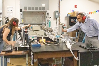The team behind the recent study test out the mini-detonation in their lab at UCF
