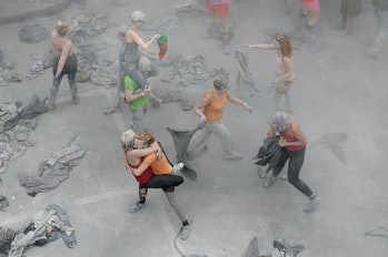 HAMBURG, GERMANY - JULY 05: Prostestors dressed-up in grey clothes like Zombies attend an arts perfo...