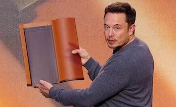 Elon Musk demonstrating the Tesla solar roof in October.