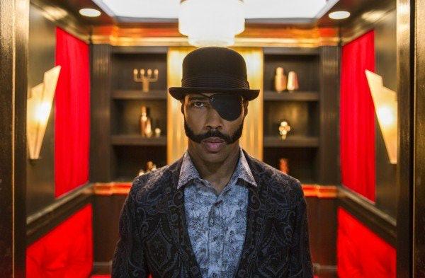 "Omari Hardwick plays ""Mr. Blank,"" a nameless supervisor who dresses so stylized it looks like a costume."