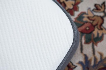 The top and edge of the Casper mattress. The textured cover is smooth, but in our testing it caught a couple of snags. The lip at the edge helps secure fitted sheets.