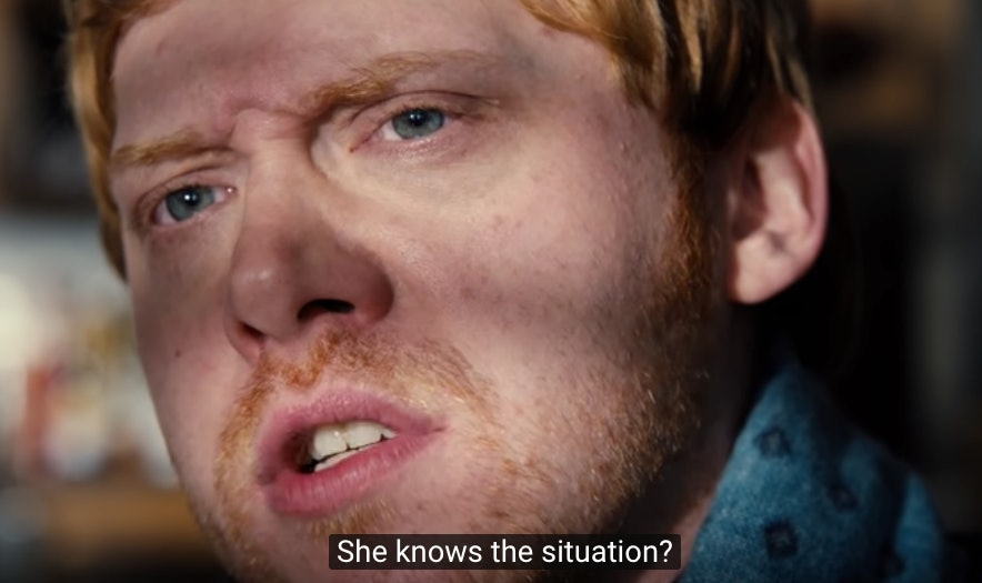 """Rupert Grint plays Julian Pearce, Dorothy's younger brother. Here, he is asking if the nanny is cool with the fact that the """"baby"""" she has been hired to look after is actually a doll."""