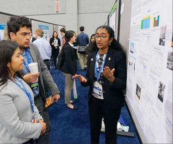 Meghana Bollimpalli presents her research at the American Junior Academy of Science.